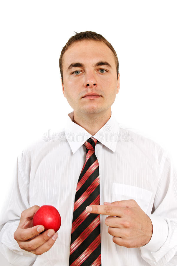 Young man with apple. royalty free stock image