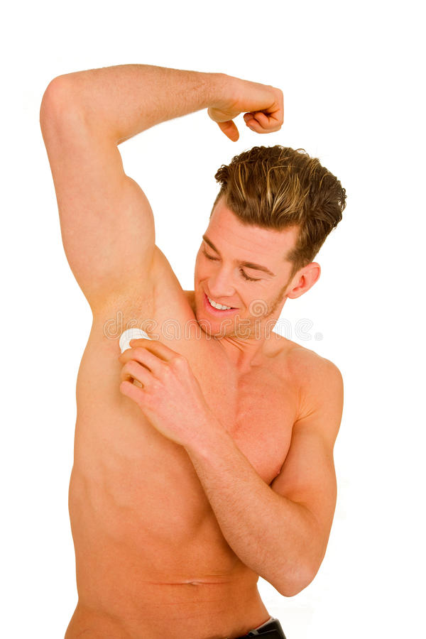 Young man applying deodorant royalty free stock images