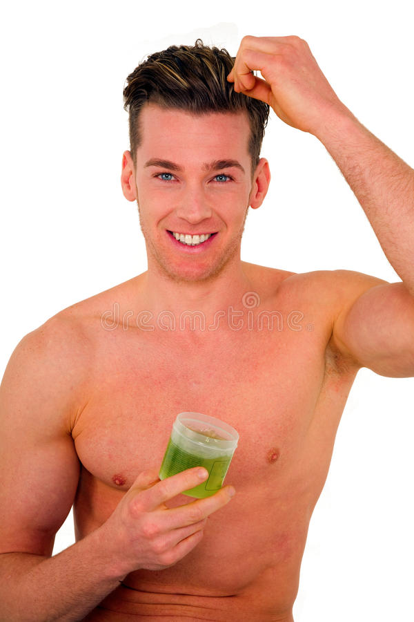 Young man applying gel on hair royalty free stock photos