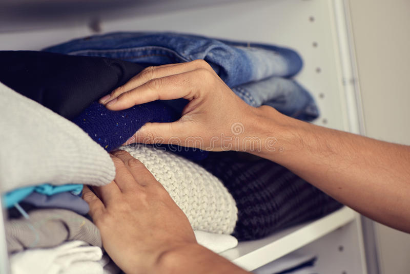 Young man arranging the closet stock image