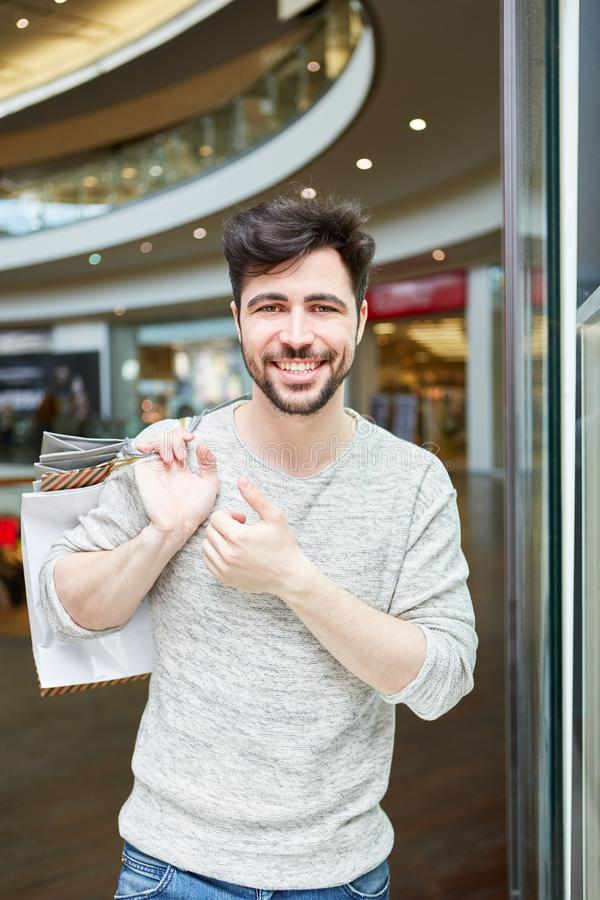Young man as a consumer and customer. In retail while shopping royalty free stock images