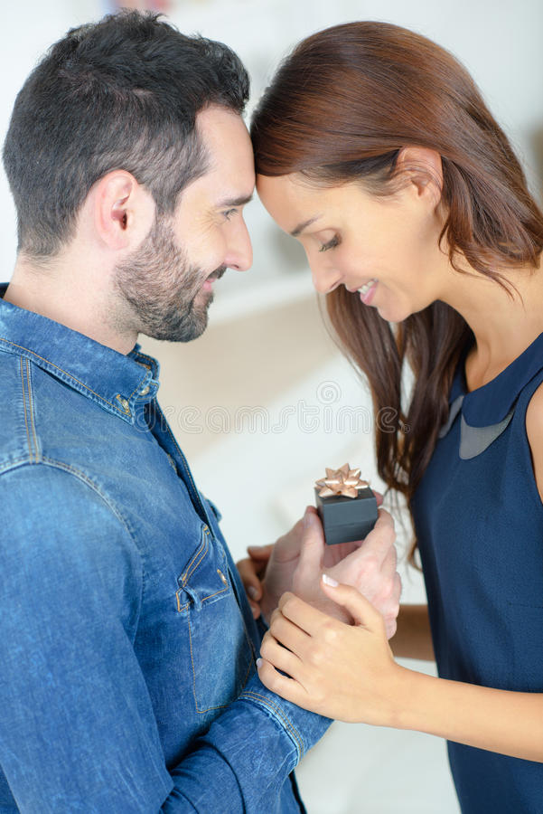 Young man asking beautiful girl for hand royalty free stock photos