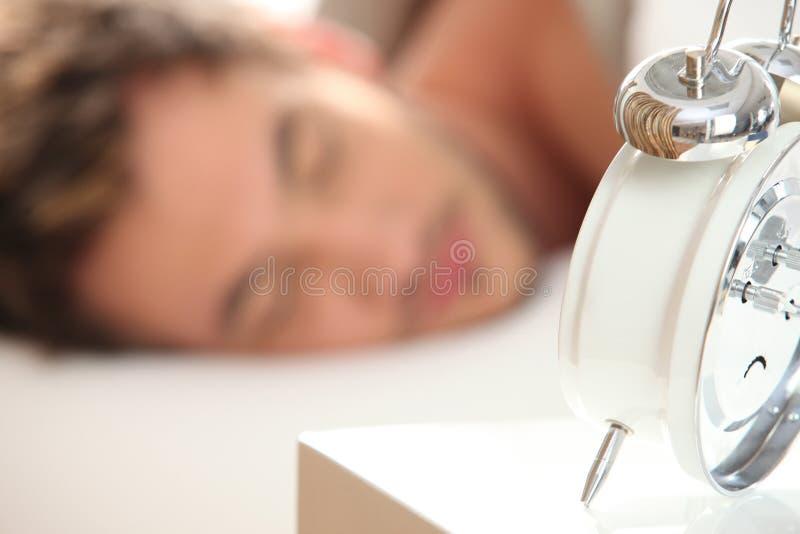 Young man asleep stock image
