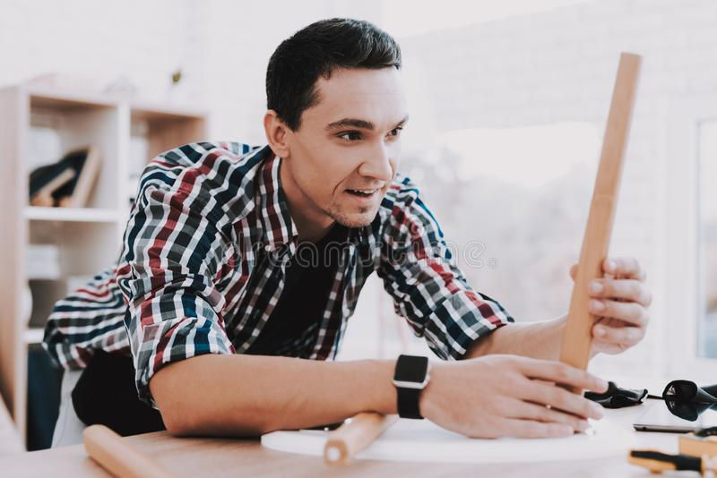 Young Man Assembling Coffee Table and Stools stock photos