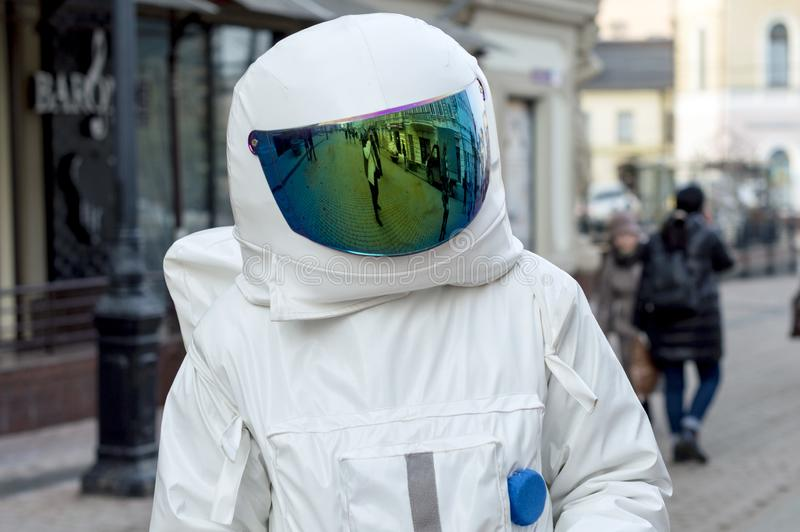 A young man in an astronaut suit, handing out leaflets on the street . Nizhny Novgorod, Russia - 17 March 2017: A young man in an astronaut suit, handing out stock image