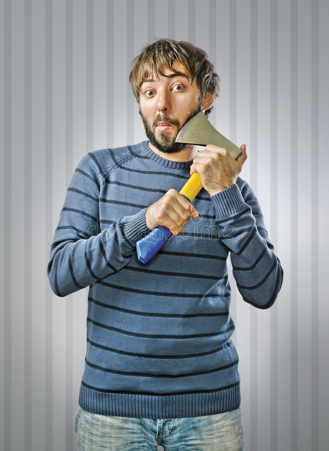 Young Man with Axe. Young Man Shaving with Axe royalty free stock photos