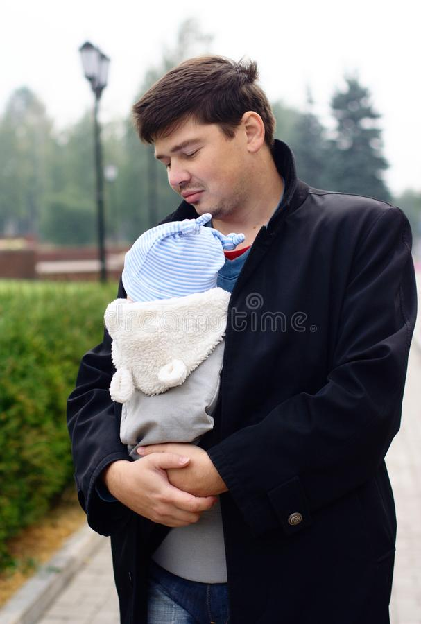Young Man With Baby In A Sling Royalty Free Stock Image