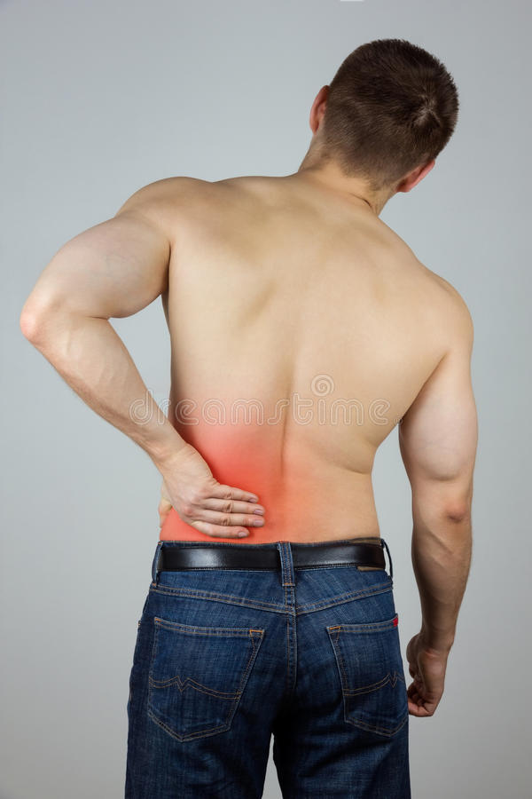 Young man with back pain stock images