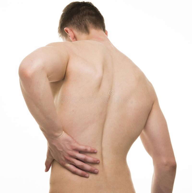 Young man with back pain - Studio shot isolated on white stock photo