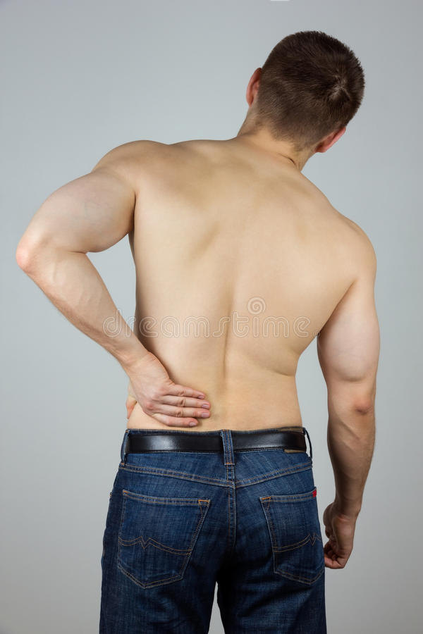 Young man with back pain royalty free stock image