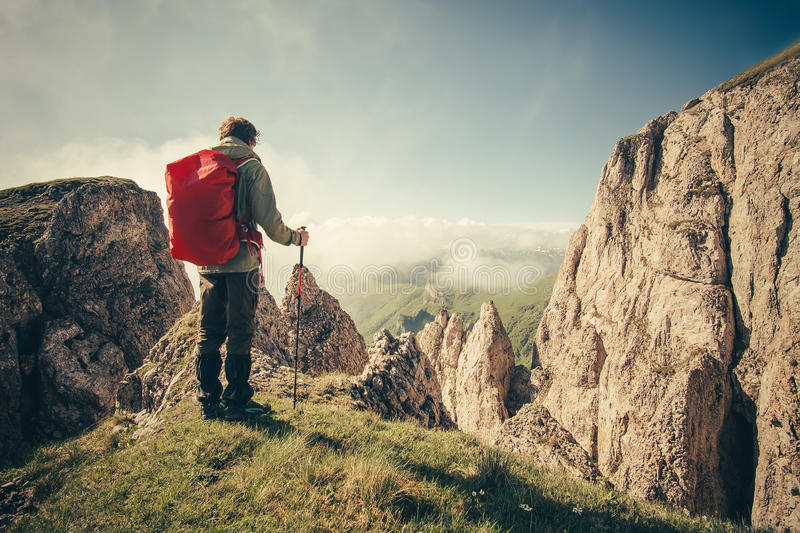 Young Man with backpack hiking outdoor Travel royalty free stock photos