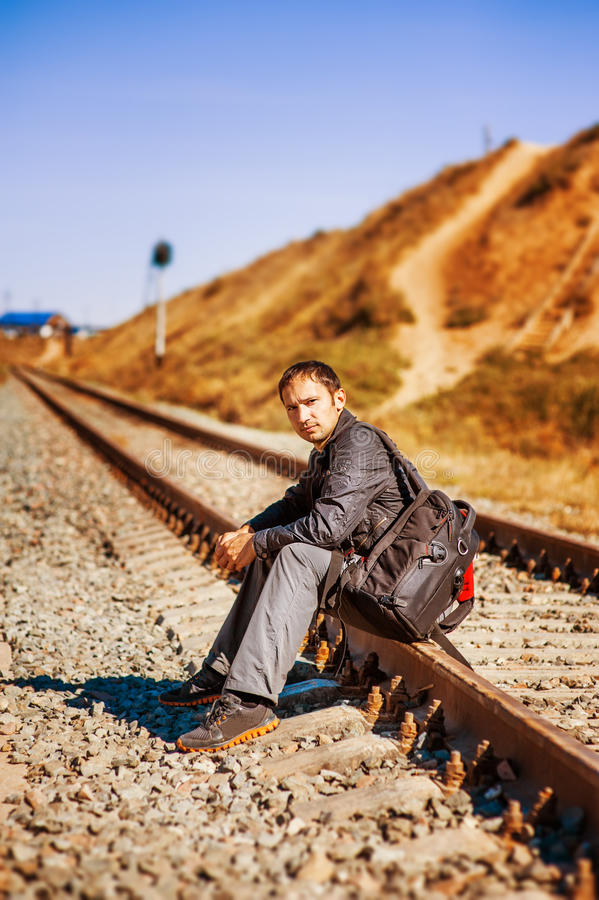 Young man with backpack on railroad stock images
