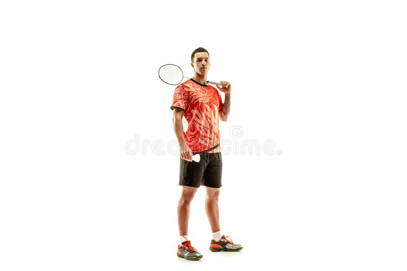 Young male badminton player over white background. Young man badminton player standing over white studio background. Fit male athlete stock photos