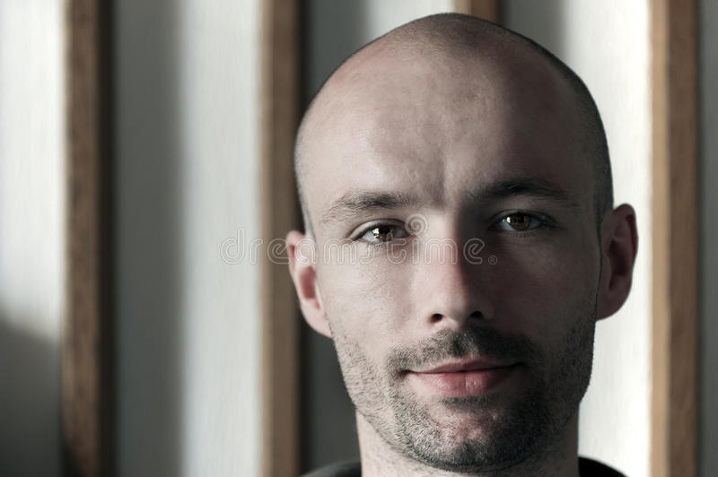 Young man with a bald head stock images