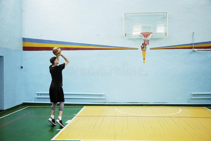 Basketball player in action in a basketball court stock images