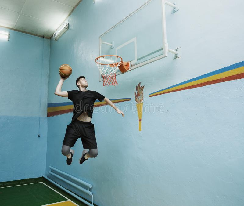Basketball player in action in a basketball court royalty free stock images
