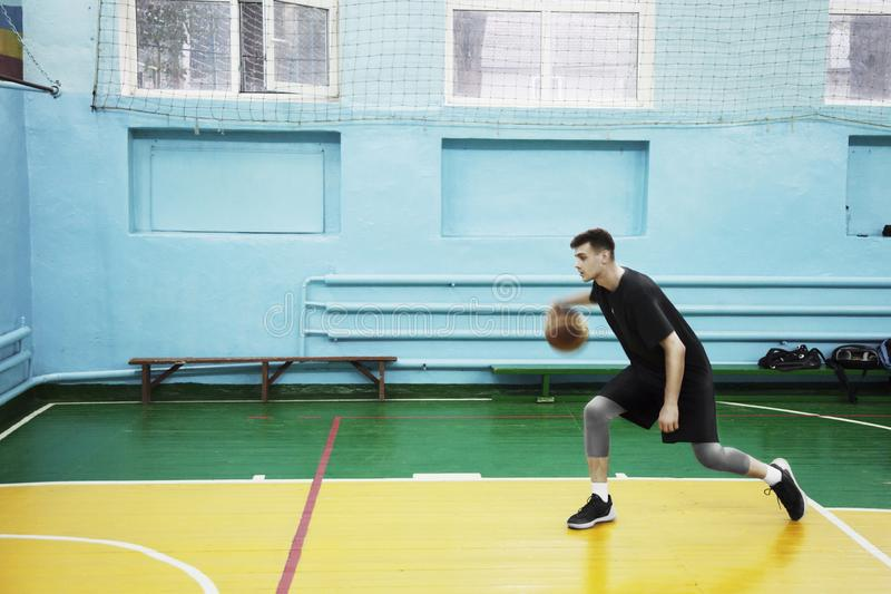 Basketball player in action in a basketball court stock photo