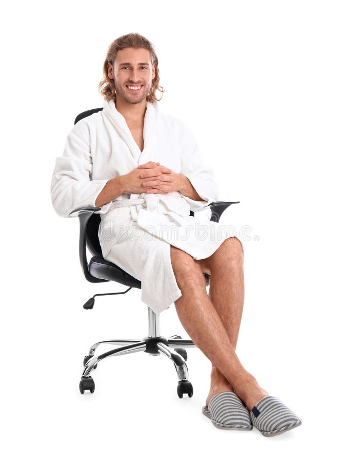 Young man in bathrobe on white background. Young man in bathrobe on white royalty free stock photography