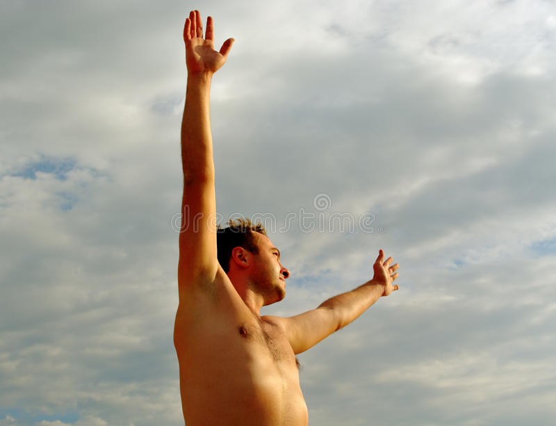 Young man on the beach. stock image