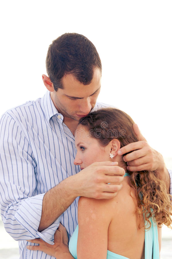 Download Young Man On Beach Comforting Young Lady Royalty Free Stock Photography - Image: 9630187