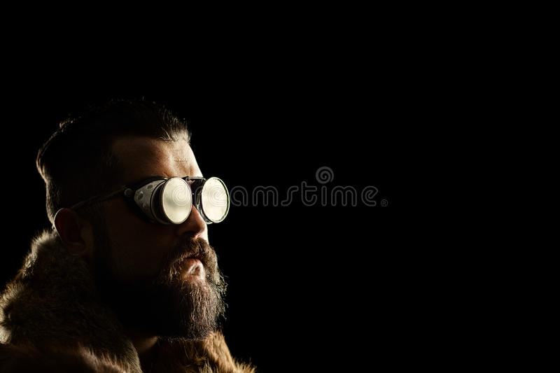 Young man with a beard and black goggles royalty free stock photo
