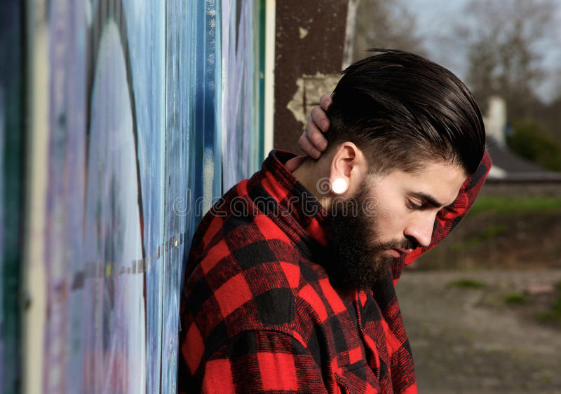 Young man with beard and piercings outdoors stock photos