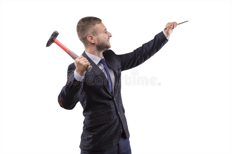 Young man beats hammer on the chisel stock images