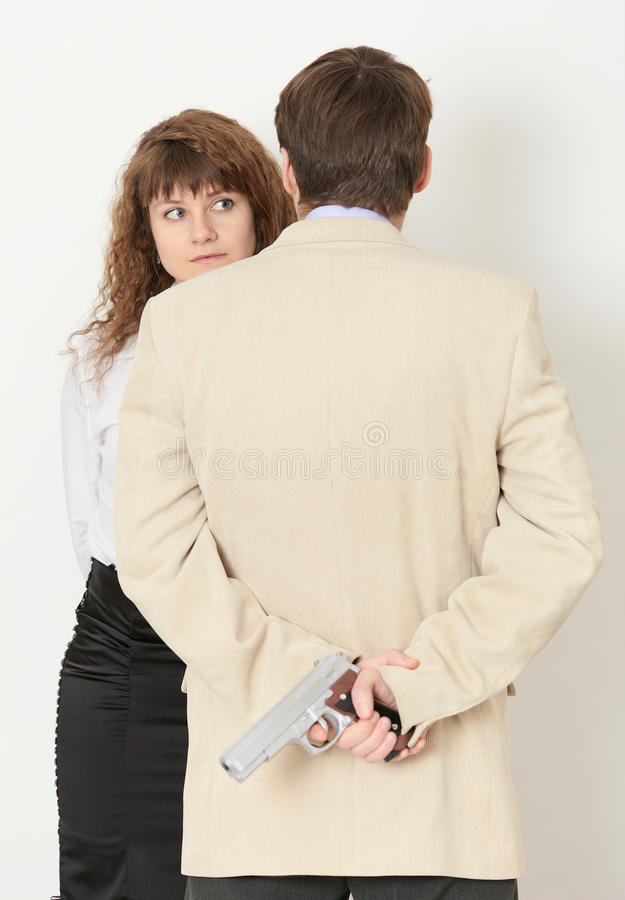 Download Young Man And A Beautiful Woman. Gun In Hand Stock Photo - Image of adult, romantic: 12832204