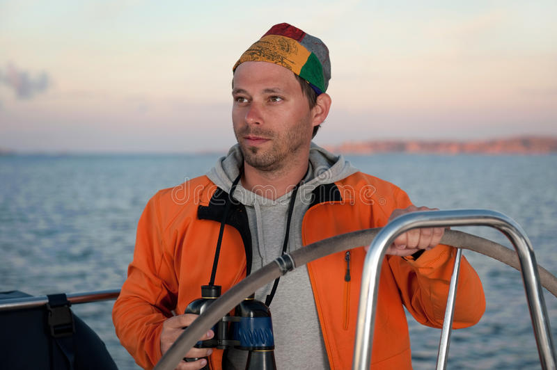 Download Young Man With Binocular On Yacht Stock Photo - Image: 15446778