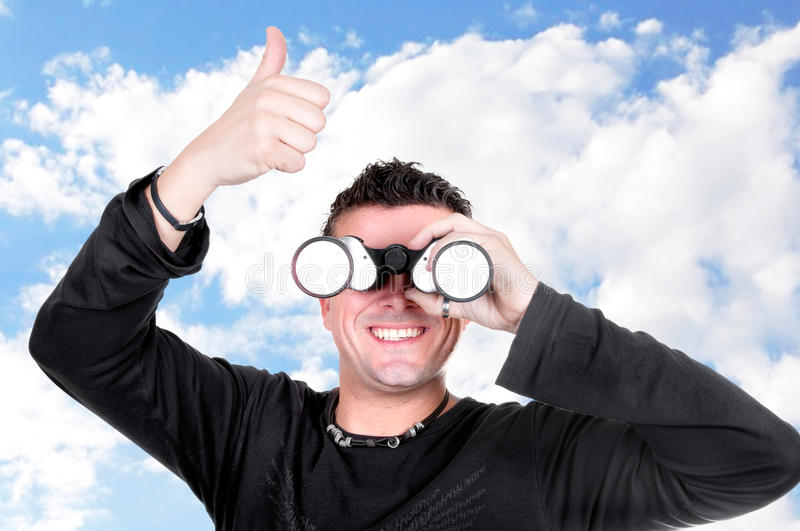 Young man with binoculars royalty free stock image