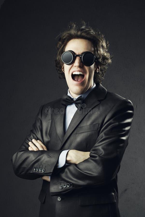 Young man bizarre screaming stock photos