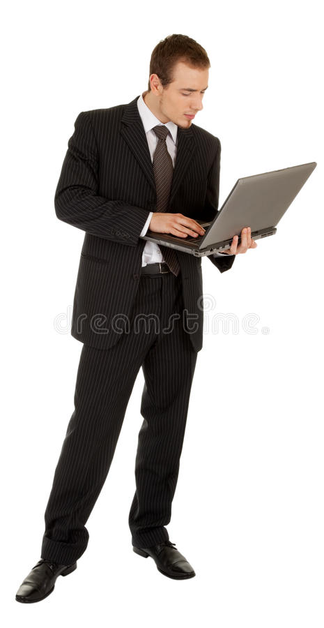 Young man in a black business suit with a laptop