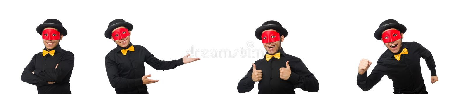Young man in black costume and red mask isolated on white. The young man in black costume and red mask isolated on white stock image