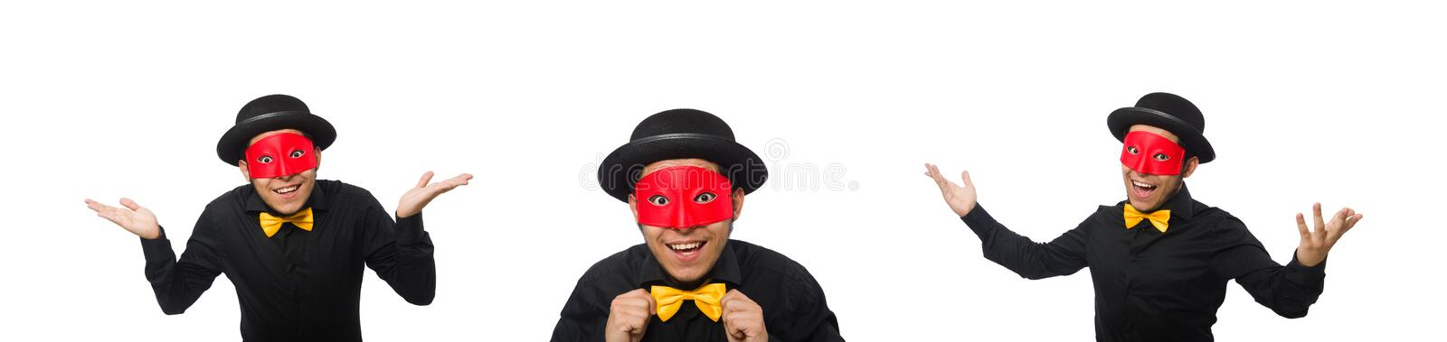 Young man in black costume and red mask isolated on white. The young man in black costume and red mask isolated on white stock photo