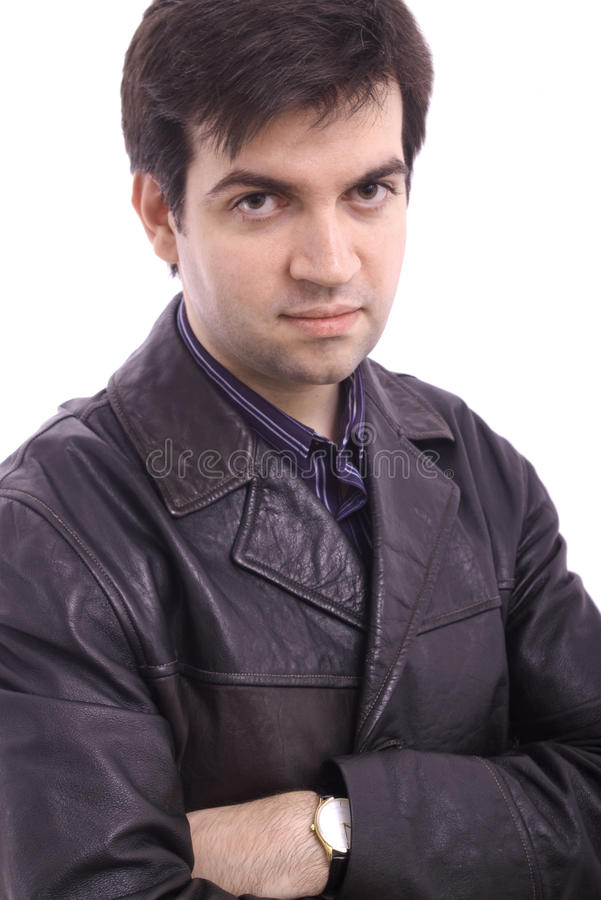 Young man in a black leather jacket stock image