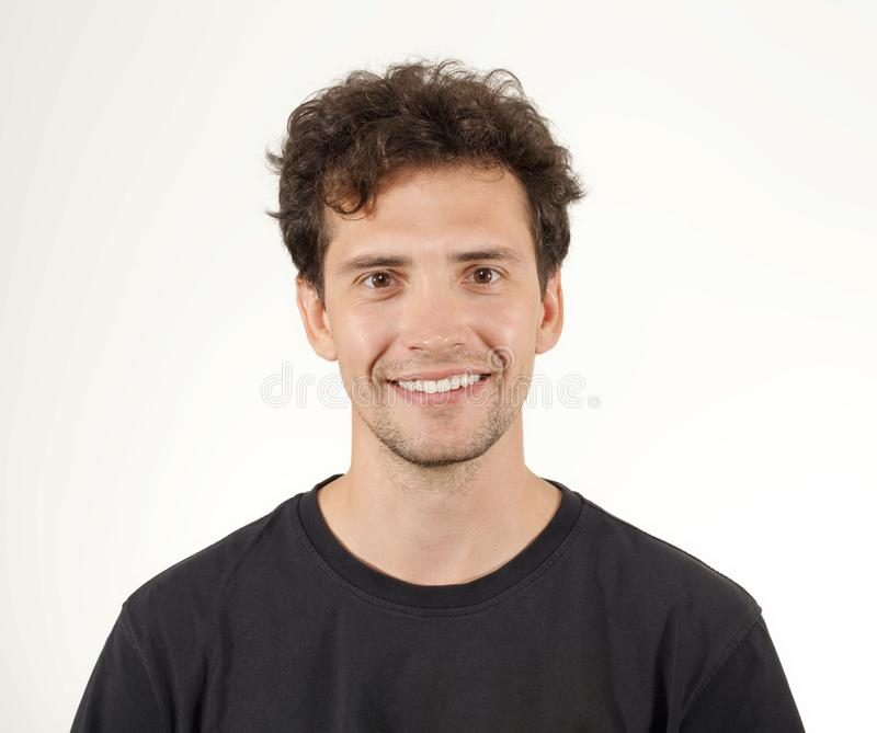 Young man in black shirt smiling portrait royalty free stock image