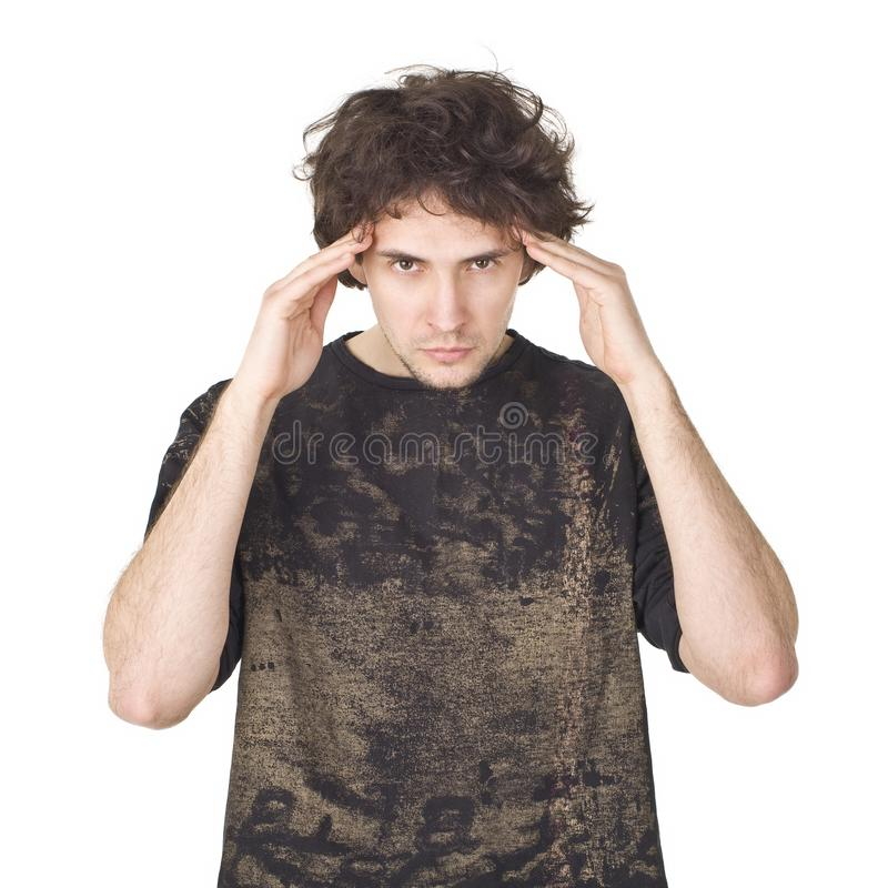 Young man in black shirt on whit background concentrating stock images