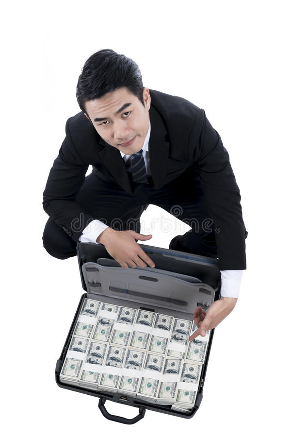 The young man in black suit open briefcase and finger pointing t stock image