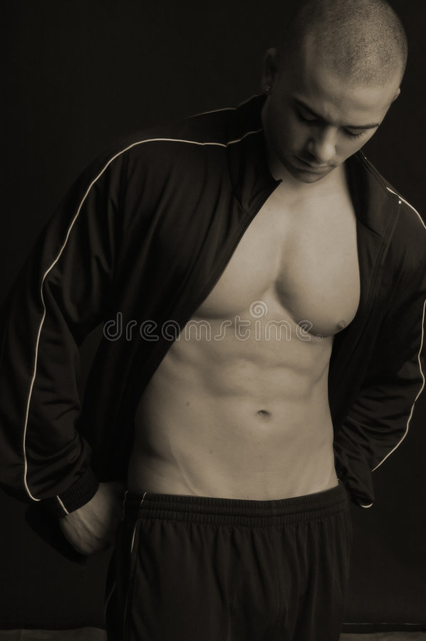 Young man in black sweatsuit stock images