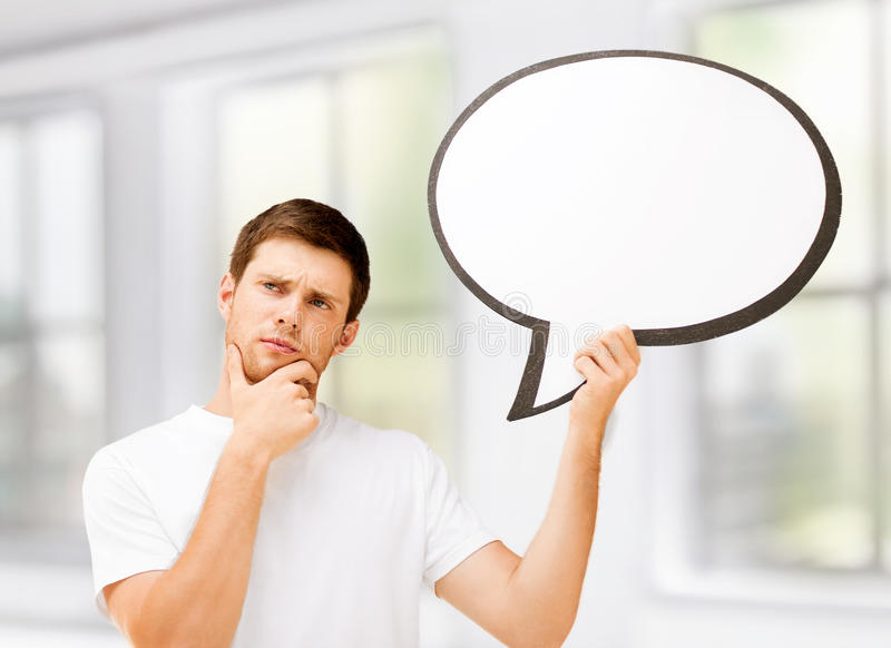 Young man with blank text bubble. Picture of thinking young man with blank text bubble stock photography
