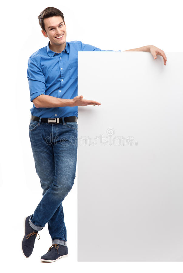 Young man by blank whiteboard stock images