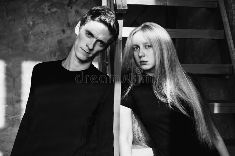 A young man and young blonde woman with long hair. Problems and difficulties in relations. Difficult situation in life. Conceptual stock photography