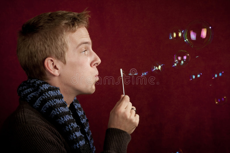 Young Man Blowing a Bubbles stock photos