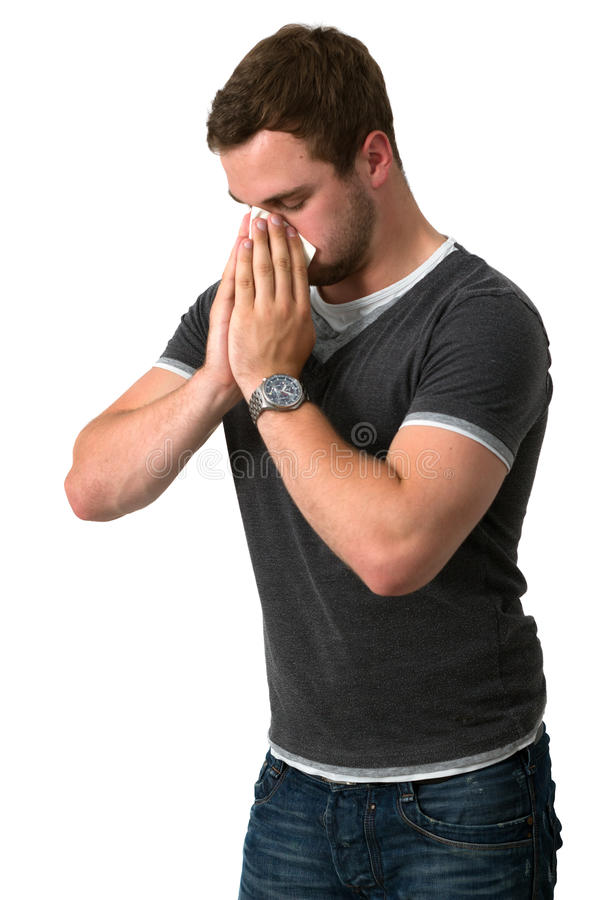 Young Man Blowing Nose