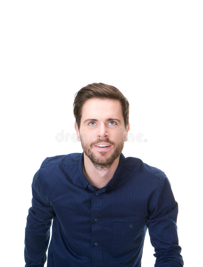 Young man with blue shirt smiling and looking up stock photography