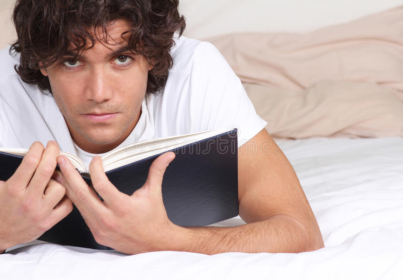 Young man with a book royalty free stock photos