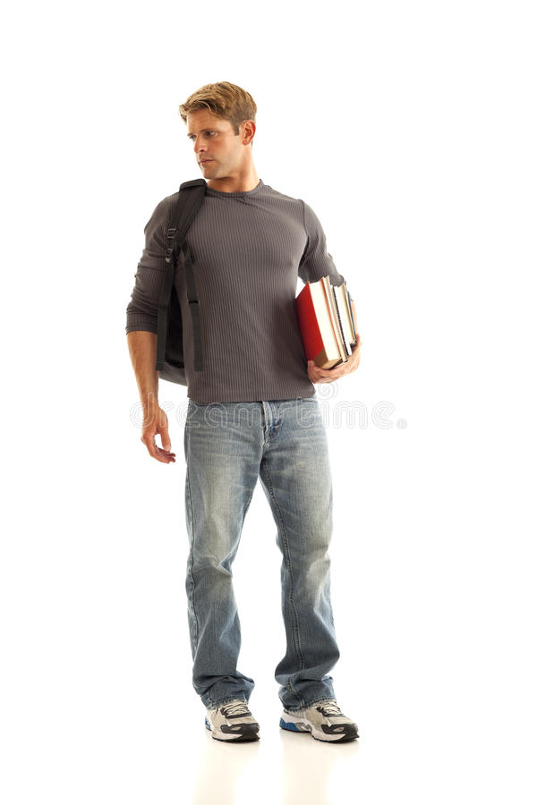 Young Man With Books And Backpack Stock Image