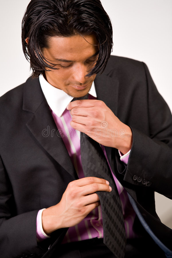 Young man bounding his necktie royalty free stock photography