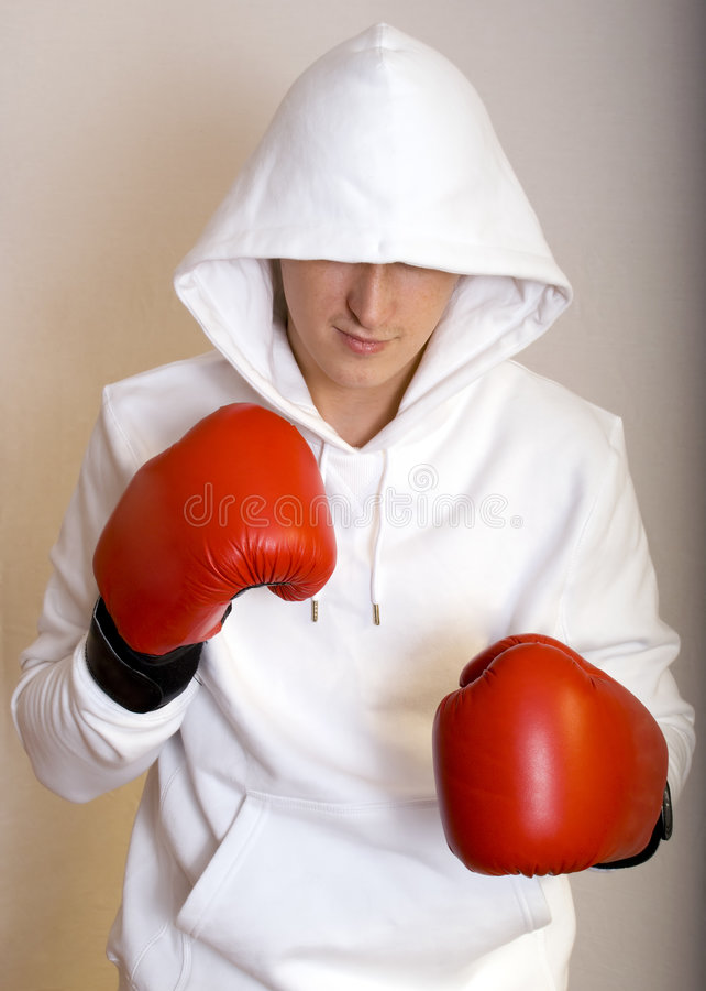 Young man with boxing gloves on royalty free stock images