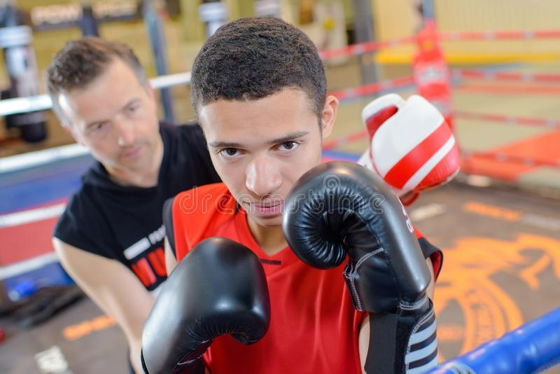 Young man in boxing ring stock images